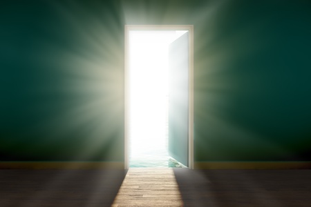 View of bright, blinding sun, seen through an open door.