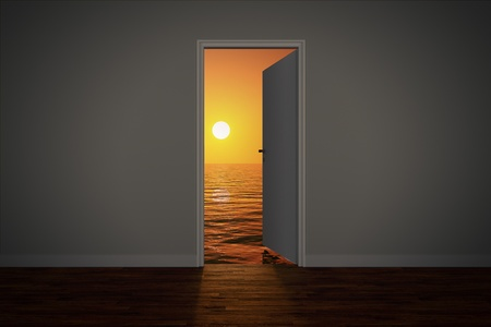 View of the sunset sea, seen through an open door.