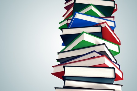pile of books: Stack of colorful hardcover books. Isolated on light background.