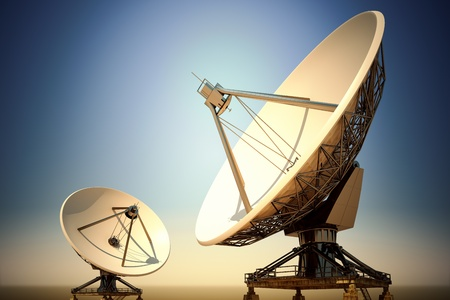 airwaves: Two big satellite dishes aimed into space. Parabolic antennas in twilight.
