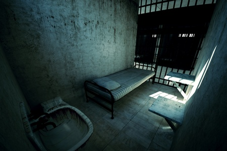 Render of locked old prison cell for one person with bed, sink, toilet and chair. Dark atmosphere. Stock Photo
