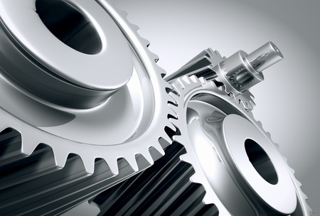 connection: Close up of a group of interlocking stainless steel gears.