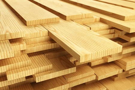lumber: Large stack of wood planks.