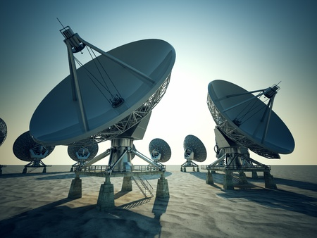 Satellite dishes on the bright blue sky background. Stock Photo