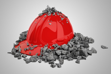 Red safety helmet and brick broken into pieces.