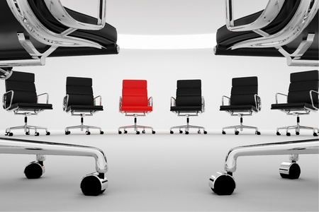 Red chair between regular, black office chairs