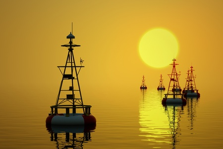 Buoys floating on the sea at the setting sun  Stock Photo