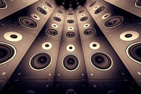 A wall of brown, wooden loudspeakers