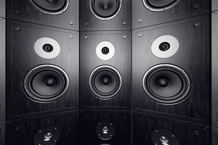 Black, wooden loudspeakers in a stack