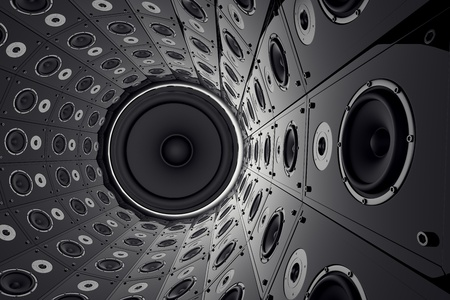 A huge round wall made of black loudspeakers