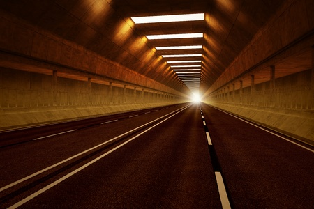 Driving through a dark car tunnel. Dimmed lights with orange tint. May represent travel, speed, transportation or urban communication.