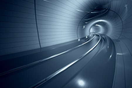 Inside the modern subway corridor. Curved line of the train tracks. May represent travel, speed, urban communication or futuristic technology.