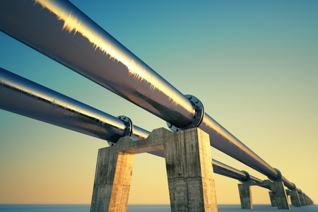 gas supply: Bottom shot of a pipeline at sunset. Pipeline transportation is most common way of transporting goods such as Oil, natural gas or water on long distances.