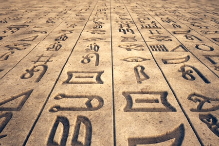 hieroglyphs: Image that presents ancient writings, hieroglyphs engraved on a stone wall.