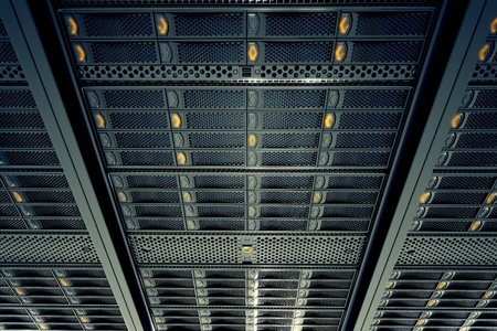 Bottom view on data servers while working. Blue LED lights are flashing. Image can represent cloud computing, information storage, etc. or can be the perfect technology background.  Archivio Fotografico