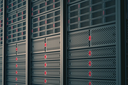 Closeup on data servers while working. Red LED lights are flashing. Image can represent cloud computing, information storage, etc. or can be the perfect technology background.