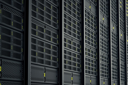 Image of data servers while working. Yellow LED lights are flashing. Image can represent cloud computing, information storage, etc. or can be the perfect technology background.