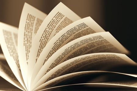 Image of a book with turning pages in sepia color scheme  Might be useful for education, litarature, wisdom illustrating purposes  photo