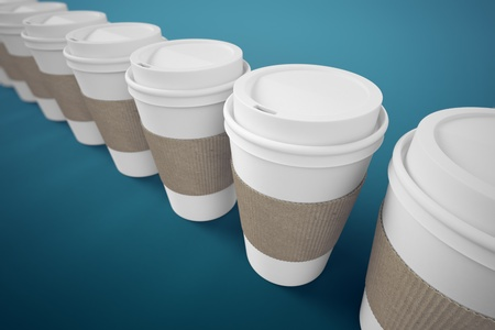 to go cup: White paper take-away coffee cups with brown holding stripe on a blue background  Suitable for cafeterias, representing breakfast, morning and freshly made coffee  Stock Photo