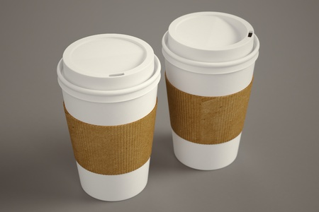 disposable: White paper take-away coffee cups with brown holding stripe on a brown background  Suitable for cafeterias, representing breakfast, morning and freshly made coffee
