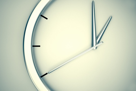 Closeup on a simple modern clock hanging on a wall on a bright background  May represent passage or shortage of time, house or office decorations