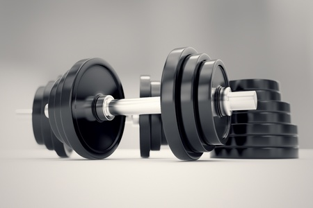 Vinyl iron dumbbels with adjustable weights on a white background. Perfect for any fitness, training or bodybuilding related purposes. Imagens