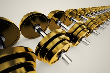 Golden dumbbels with adjustable weights on a white backround. Perfect for any fitness, training or bodybuilding related purposes.