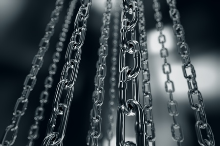 shackle: Reflective chrome chain on a dark background. Can be associated with strength, connection, industry or imprisoning.