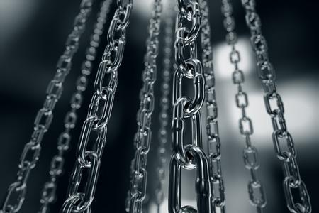 Reflektierende Chrom-Kette auf einem dunklen Hintergrund. Kann mit Stärke, Verbindung, Industrie oder Gefangen zugeordnet werden. Standard-Bild - 20038696