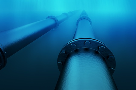 Pipeline in the blue waters of the sea.  Pipeline transportation is most common way of transporting goods such as oil, natural gas or water on long distances.