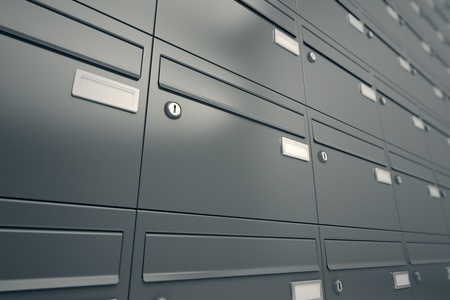 A wall of gray mailboxes. It can illustrate message, privacy or security. Useful for postal, shipment or correspondence realted purposes. Standard-Bild