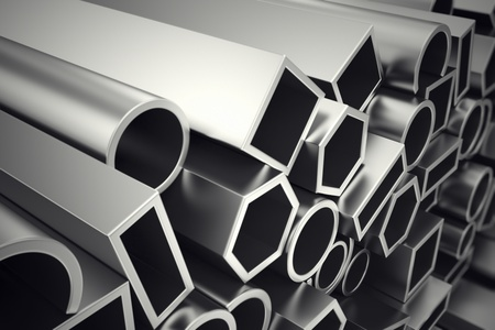 A stack of steel profiles in different shapes. They are designed to meet high demands for performance, quality and precision. They are used in construction and manufacturing.  Standard-Bild