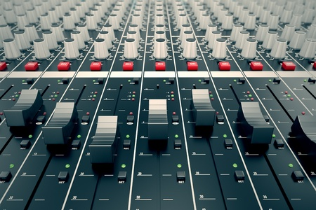 recordings: Closeup on a sliders of a mixing console. It is used for audio signals modifications to achieve the desired output. Applied in recording studios, broadcasting, television and film post-production. Stock Photo