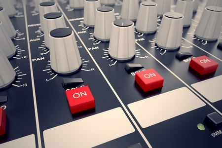 music production: Closeup on adjusters and red buttons of a mixing console. It is used for audio signals modifications to achieve the desired output. Applied in recording studios, broadcasting, television and film post-production.