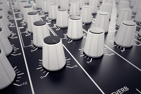 Closeup on white adjusters of a mixing console. It is used for audio signals modifications to achieve the desired output. Applied in recording studios, broadcasting, television and film post-production.