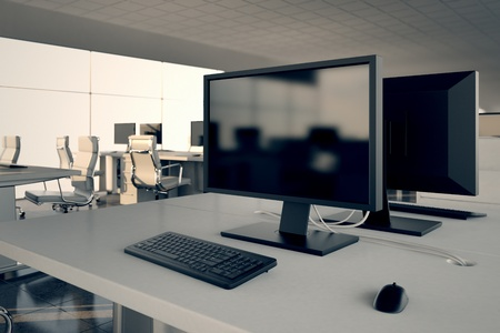 desktop computers: Closeup on a white office desk with a monitor and keybord on top  Illustrates arrangement and furnishing of a modern office interior, comfortable business space and professionalism