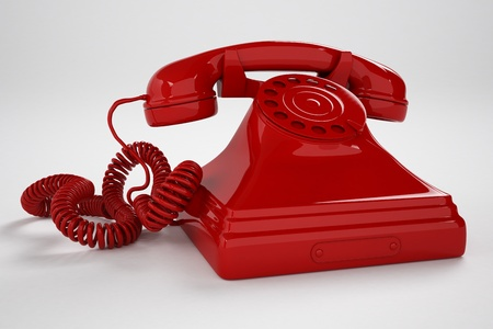 Isolated old-fashioned red telephone on a white background  It can represent tradicional communication or vintage style  Stock Photo - 20038670