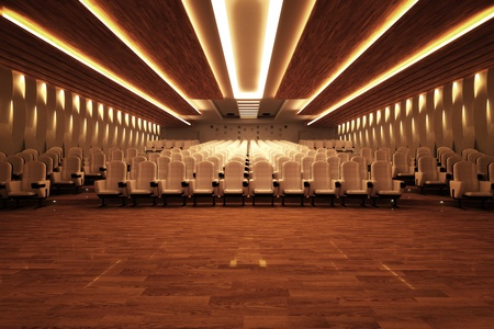 auditorium: Front shot of a large empty cinema with comfortable white leather seats and a wooden floor. Stock Photo