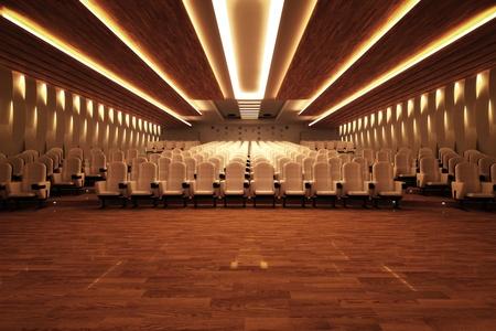 Plan frontal d'une grande salle de cin�ma vide avec des si�ges en cuir blanc confortables et d'un plancher en bois.