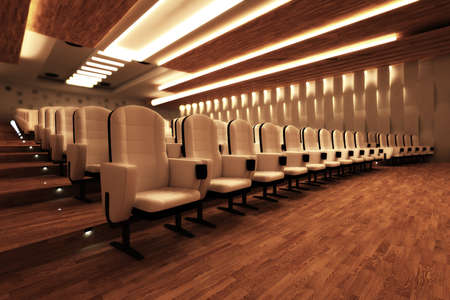 Rows of comfortable white leather seats and a wooden floor in a large empty cinema. Stock Photo