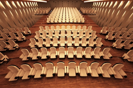 convention hall: Top shot of a large empty cinema with comfortable white leather seats and a wooden floor. Stock Photo