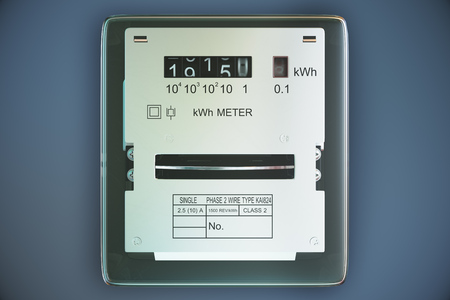 Typical residential analog electric meter with transparent plactic case showing household consumption in kilowatt hours. Electric power usage. Foto de archivo