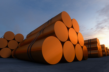dawn sky: Stacks of cylindrical copper billets. In background cloudless dawn sky.