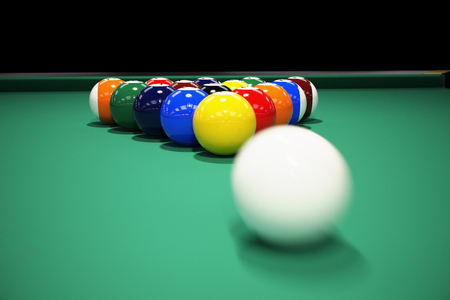 cue sticks: Billiard balls on the green baize of a billiard table. Breaking the rack in pool.Strong shot of cue ball.