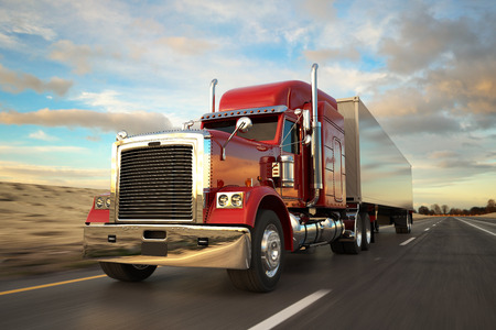 trucker: 18 Wheel Truck on the road during the day. Side view. Stock Photo