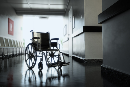 mobility nursing: Standard manual wheelchair standing in empty hospital corridor