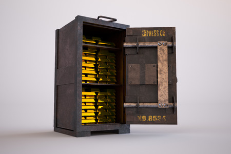 Gold bullion bars stacked tightly in an old safe with its door standing wide open in a conceptual image of finances and wealth