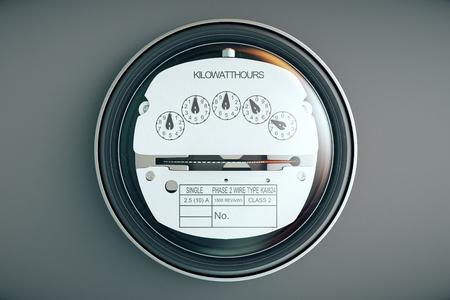 Típico medidor eléctrico analógico residencial con el caso plactic transparente que muestra el consumo de los hogares en kilovatios-hora. El uso de energía eléctrica. Foto de archivo