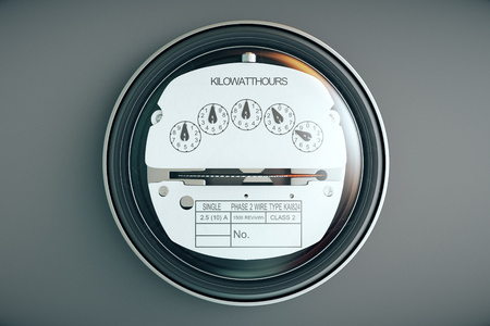 Typical residential analog electric meter with transparent plactic case showing household consumption in kilowatt hours. Electric power usage. Archivio Fotografico