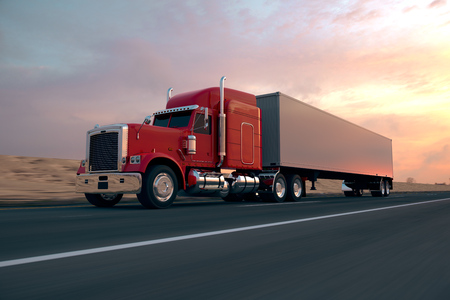 global logistics: 18 Wheel Truck on the road during the day. Side view. Stock Photo